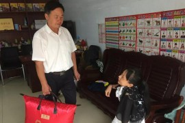 启东肢协重阳节开展关爱老年肢残人活动